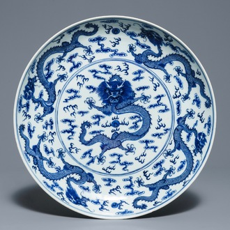 A Chinese blue and white 'dragon' dish, Qianlong mark, 19th C.