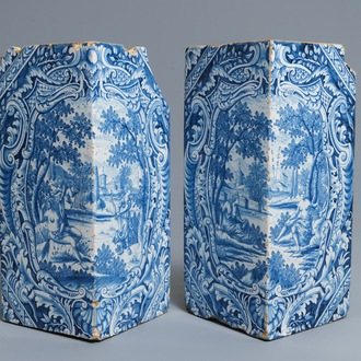 A pair of blue and white mythological subject corner tiles for a stove, Hamburg, Germany, 18th C.