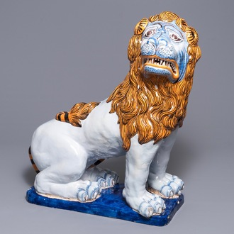 A massive French faience model of a lion, Rouen, 19th C