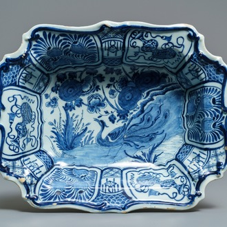 A rectangular Dutch Delft blue and white salad bowl with a peacock, 18th C.