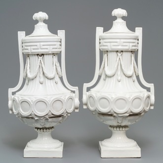 A pair of tall neoclassical Sevres-style covered vases, France or Germany, 18/19th C.