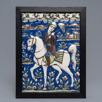 A rectangular Qajar relief-moulded tile with a prince on horseback, Iran, 19th C.