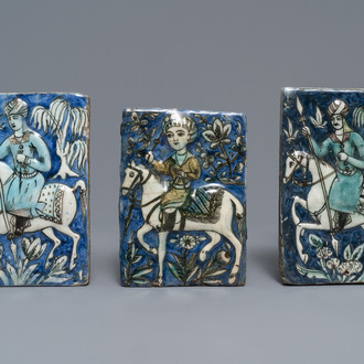 Three Qajar relief-moulded tiles with soldiers on horseback, Iran, 19th C.