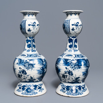 A pair of tall Dutch Delft blue and white chinoiserie vases, early 18th C.