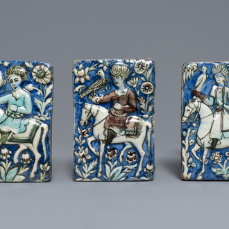 Three Qajar relief-moulded tiles with falconers, Iran, 19th C.