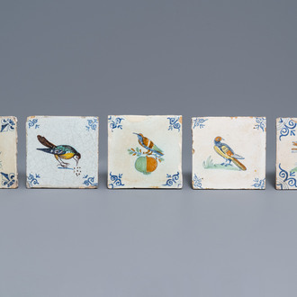 Five polychrome Dutch Delft tiles with birds and a dog, 17th C.