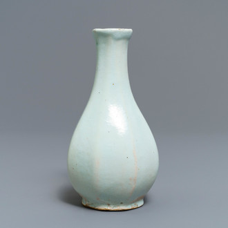 An octagonal white Delftware bottle vase, Dutch or French, 18th C.