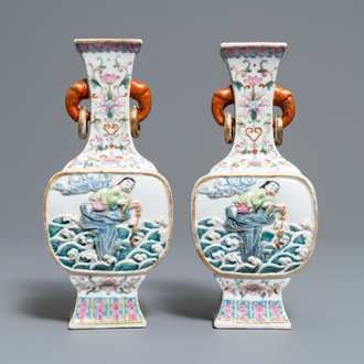 A pair of Chinese famille rose relief-decorated 'Liu Hai' vases, Qianlong mark, 19th C.