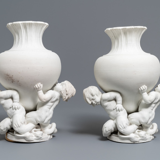 A pair of biscuit vases with young tritons, Saint-Amand or Tournai, 18th C.