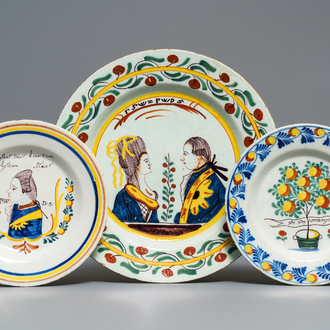 Two polychrome Dutch Delft 'orangist' plates and a dish, 18th C.