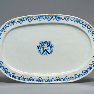 A large blue and white oval French faience dish with the arms of Barres, Rouen, 18th C.