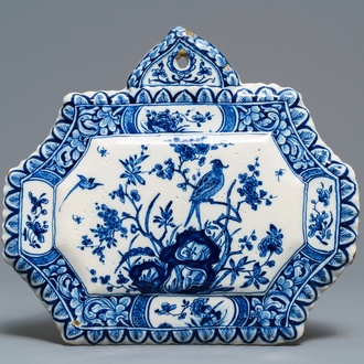 A Dutch Delft blue and white plaque, dated 1725