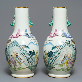 A pair of Chinese famille rose vases with figures in a landscape, 19/20th C.