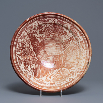 A large Hispano-Moresque lusterware charger with a bird, Valencia or Manises, Spain, 16/17th C.