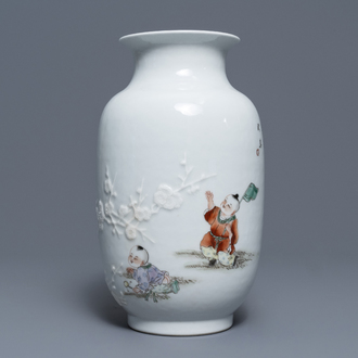 A Chinese famille rose relief-decorated vase with playing boys, Qianlong mark, Republic, 20th C.