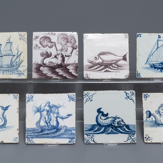 Eight Dutch Delft blue and white and manganese tiles with ships and sea creatures, 17/18th C.