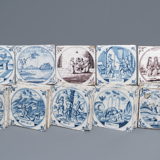 A collection of 54 biblical Dutch Delft blue and white and manganese tiles, 18th C.