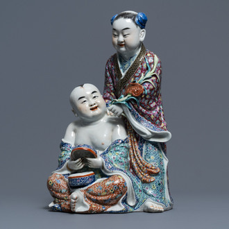 A Chinese famille rose group of two children, impressed marks, Republic, 20th C.