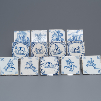 Fifteen Dutch Delft blue and white tiles with horseriders and animals, 17/18th C.