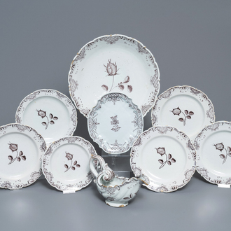 A manganese Dutch Delft part service with a sauce boat on stand, a dish and six plates, 18th C.