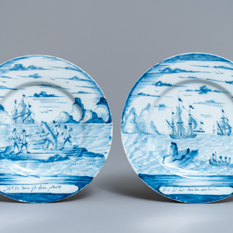 A pair of Dutch Delft blue and white 'whaling' plates, 18th C.