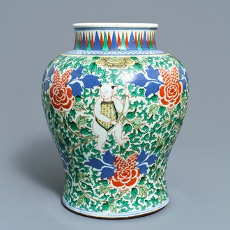 A Chinese wucai 'boys and peony scrolls' vase, 19th C.