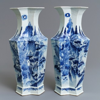 A pair of Chinese blue and white 'landscape and calligraphy' vases, 19th C.