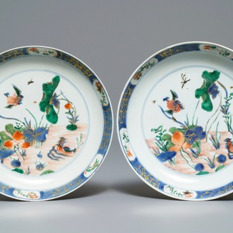 A pair of Chinese famille verte 'ducks in a lotus pond' plates, Kangxi