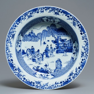 A deep Chinese blue and white dish with figures in a garden, Yongzheng
