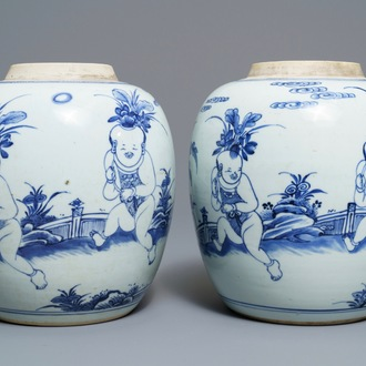 A pair of Chinese blue and white jars with boys in a garden, Kangxi
