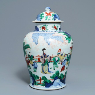 A Chinese wucai vase and cover with figures in a garden, seal mark, Transitional period