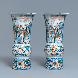 A pair of polychrome Dutch Delft chinoiserie beaker vases, 18th C.