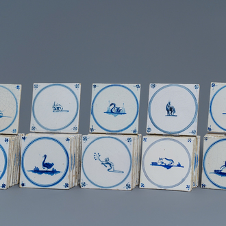 54 Dutch Delft blue and white 'animal' tiles, 18/19th C.