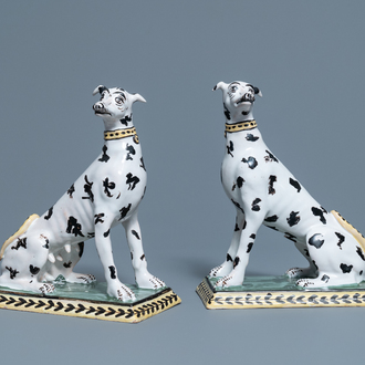 A pair of polychrome Brussels faience models of spotted greyhound dogs, 18th C.