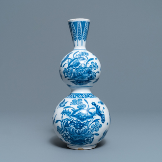 A Dutch Delft blue and white triple gourd chinoiserie vase, late 17th C.