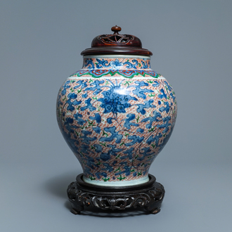 A Chinese wucai 'lotus scroll' jar with wooden cover and stand, Transitional period