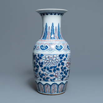 A Chinese blue, white and underglaze red vase, 19th C.