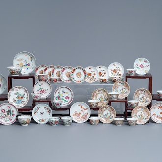 A collection of 26 Chinese famille rose cups and 28 saucers, Yongzheng/Qianlong