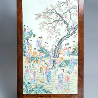 A large Chinese famille rose plaque inset in a wooden table, Republic, 20th C.