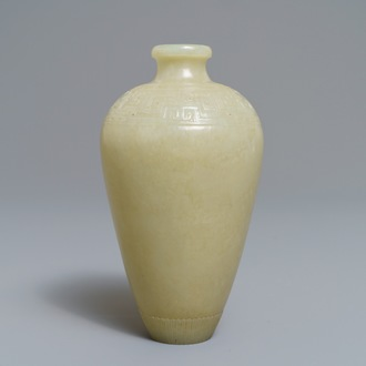A Chinese light celadon jade relief-decorated meiping vase, 19/20th C.