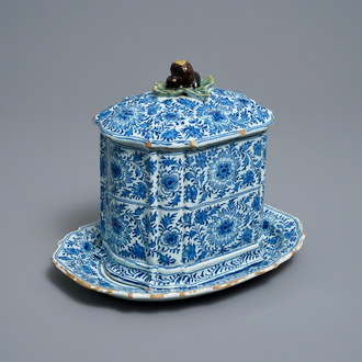 A rare Dutch Delft blue and white covered box with polychrome chestnut finial, 18th C.