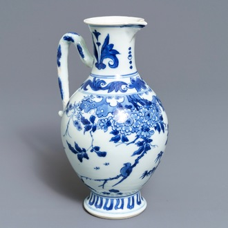 A Chinese blue and white jug with floral design, Transitional period
