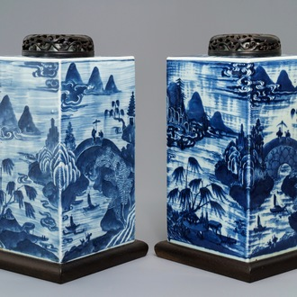 A pair of tall Chinese blue and white tea caddies with landscapes, 19th C.