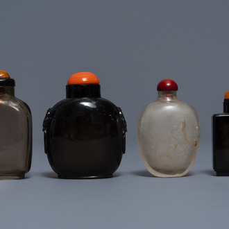 Four Chinese smoky quartz and simulating glass snuff bottles, 18/19th C.