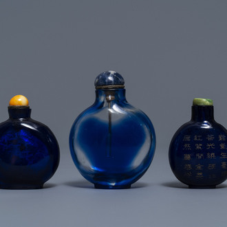 Three Chinese transparent blue glass snuff bottles, one inscribed, 18/19th C.