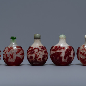 Five Chinese red overlay snowflake glass snuff bottles, 18/20th C.