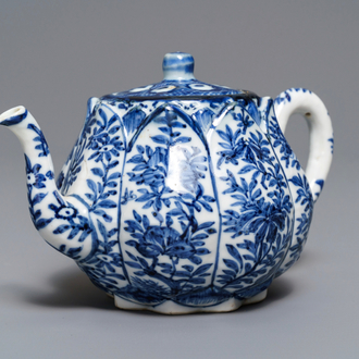A Chinese blue and white relief-moulded 'lotus flower' teapot and cover, Kangxi