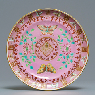 A Chinese pink-ground famille rose Pan family Straits market plate, Guangxu mark, 19th C.