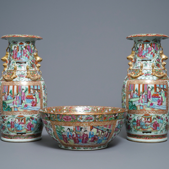 A pair of Chinese Canton famille rose vases and a bowl, 19th C.