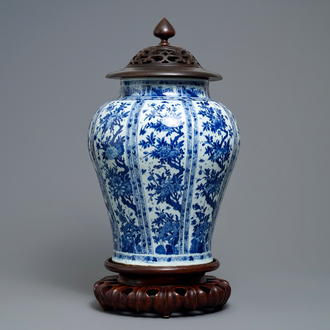 A large Chinese blue and white baluster jar with wooden cover and stand, kangxi